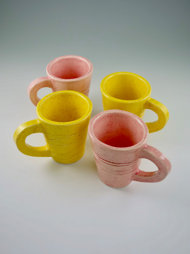 Pink and Yellow Coffee Mugs by Kevin Eaton